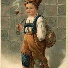 Схема вышивки «Little Boy in Ethnic Outfit of Brown Pants, Suspenders and White»